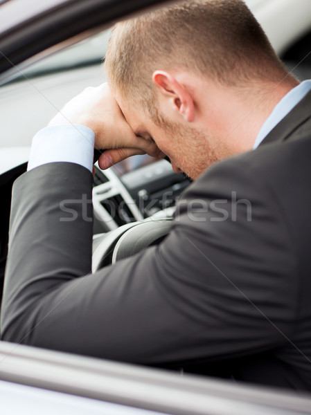 tired businessman or taxi car driver Stock photo © dolgachov