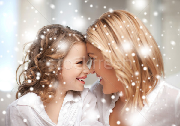 mother and daughter cuddling Stock photo © dolgachov