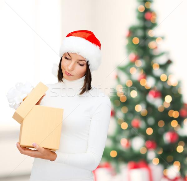 Gyanús nő mikulás segítő kalap ajándék doboz Stock fotó © dolgachov