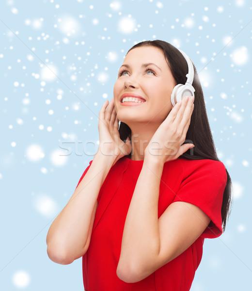 Mosolygó nő fejhallgató zene technológia mosolyog fiatal nő Stock fotó © dolgachov