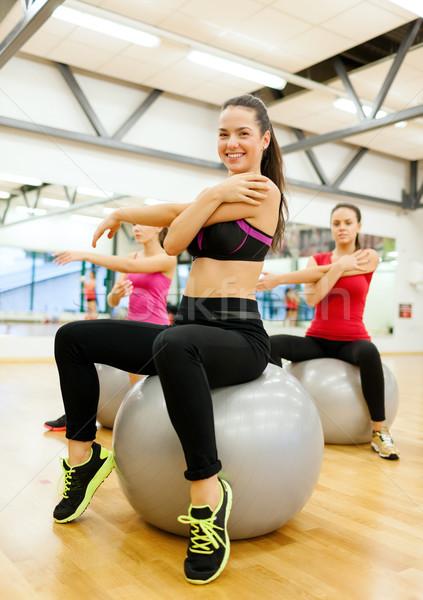 smiling people exercising in pilates class Stock photo © dolgachov