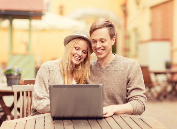 couple with laptop in cafe Stock photo © dolgachov
