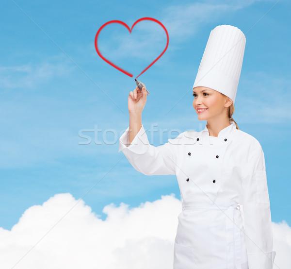 Souriant Homme chef écrit quelque chose air Photo stock © dolgachov