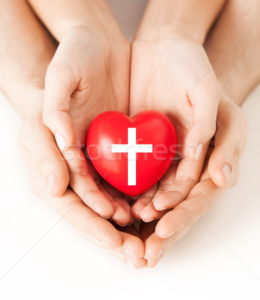 couple hands holding heart with cross symbol Stock photo © dolgachov