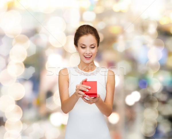 улыбающаяся женщина красный шкатулке праздников представляет Сток-фото © dolgachov
