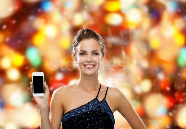 Sorrindo vestido de noite tecnologia comunicação anúncio Foto stock © dolgachov