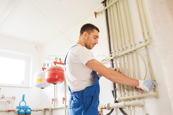 builder or plumber working indoors Stock photo © dolgachov