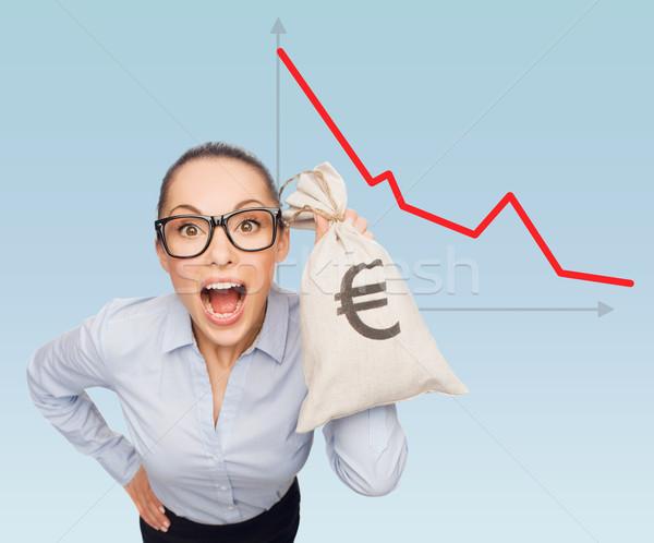 businesswoman holding money bag with euro Stock photo © dolgachov