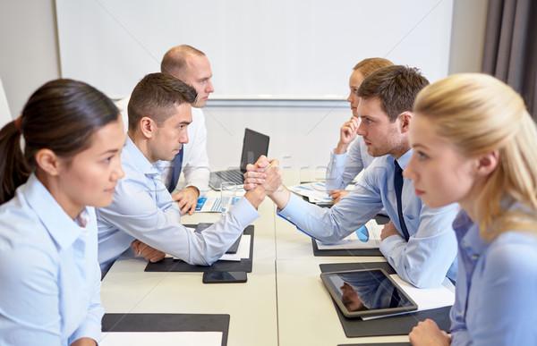 Mosolyog üzletemberek konfliktus iroda válság konfrontáció Stock fotó © dolgachov
