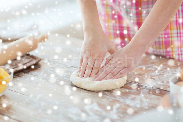 close up of female hands kneading dough at home Stock photo © dolgachov