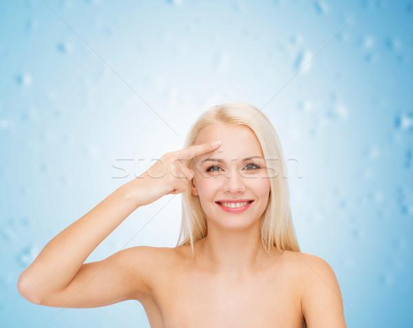Bela mulher tocante testa saúde beleza cara Foto stock © dolgachov