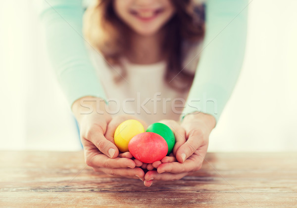 close up of girl and mother holding colored eggs Stock photo © dolgachov