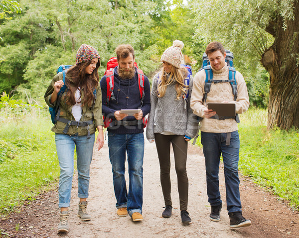 group of friends with backpacks and tablet pc Stock photo © dolgachov