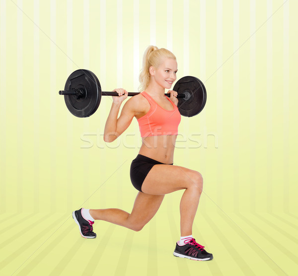 sporty woman exercising with barbell Stock photo © dolgachov