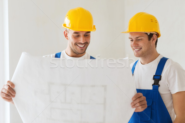 group of builders with blueprint Stock photo © dolgachov