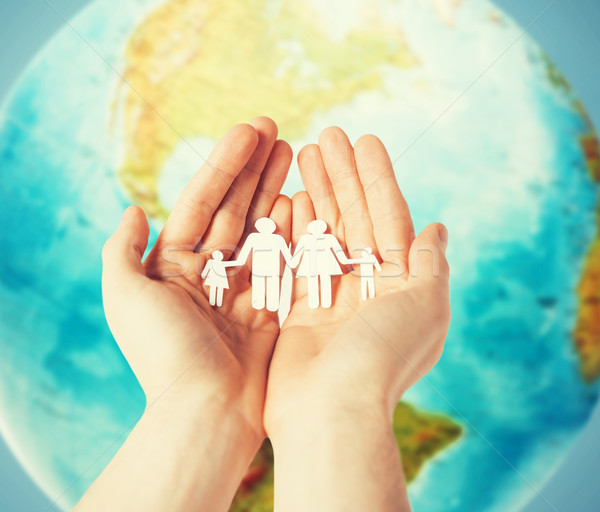 Umani mani carta famiglia terra Foto d'archivio © dolgachov