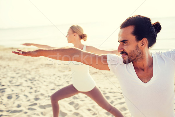 Stock photo: close up of couple making yoga exercises outdoors