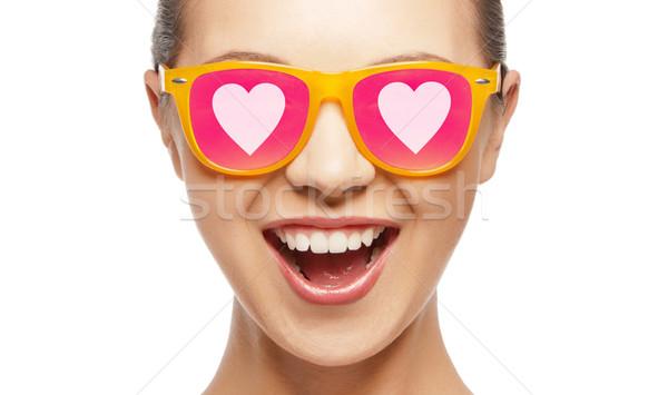 happy teenage girl in shades with hearts Stock photo © dolgachov
