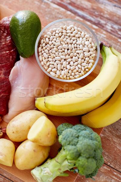 Közelkép különböző étel asztal kiegyensúlyozott étrend főzés Stock fotó © dolgachov