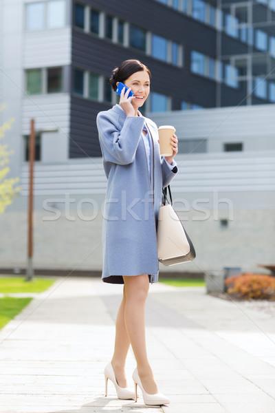 Heureux femme d'affaires appelant smartphone ville gens d'affaires Photo stock © dolgachov