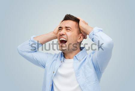 unhappy man with closed eyes touching his forehead Stock photo © dolgachov