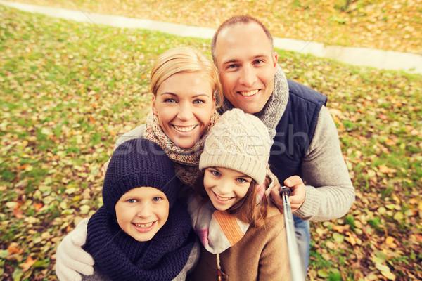 happy family with selfie stick in autumn park Stock photo © dolgachov