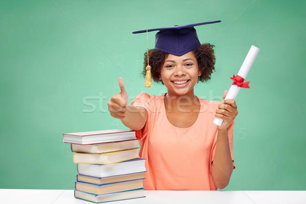 Boldog afrikai agglegény lány könyvek diploma Stock fotó © dolgachov