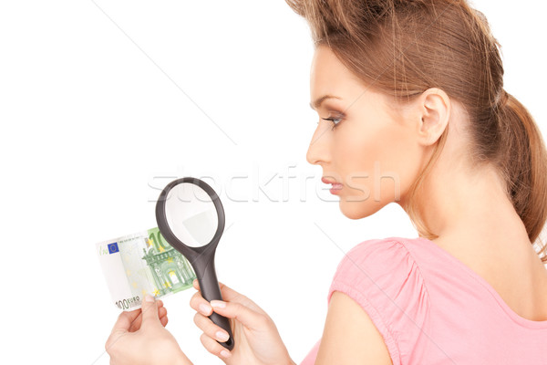 woman with magnifying glass and money Stock photo © dolgachov