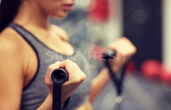 close up of woman exercising on gym machine Stock photo © dolgachov