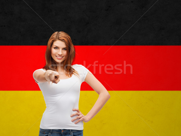 woman in t-shirt pointing at you over german flag Stock photo © dolgachov