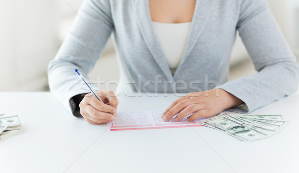 close up of woman with lottery ticket and money Stock photo © dolgachov