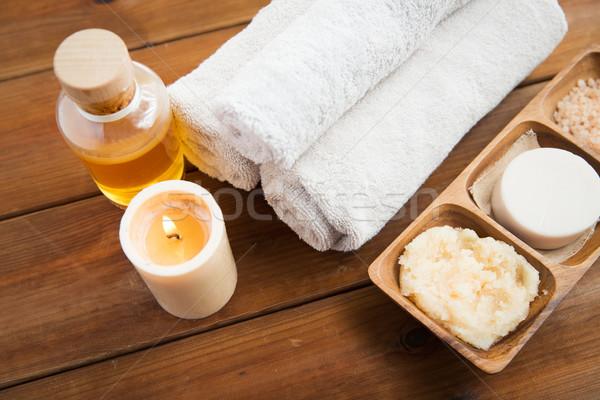 close up of natural cosmetics and bath towels Stock photo © dolgachov