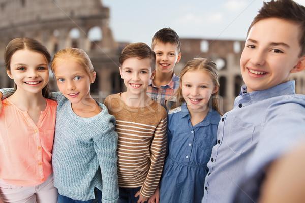 children talking selfie over coliseum in rome Stock photo © dolgachov