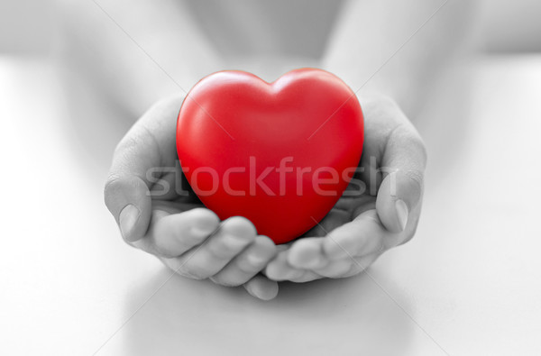 close up of child hands holding red heart Stock photo © dolgachov