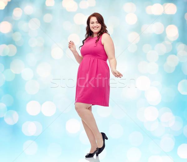 Boldog fiatal plus size nő tánc rózsaszín Stock fotó © dolgachov
