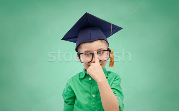 happy boy in bachelor hat and eyeglasses Stock photo © dolgachov