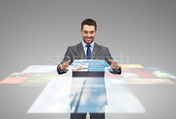 businessman working with news projection Stock photo © dolgachov