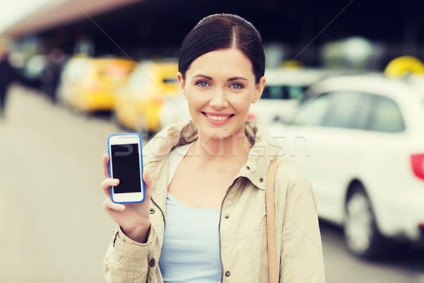 Gülümseyen kadın taksi şehir seyahat Stok fotoğraf © dolgachov
