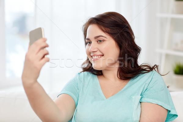 Boldog plus size nő okostelefon otthon emberek Stock fotó © dolgachov