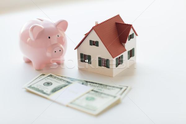 close up of house model, piggy bank and money Stock photo © dolgachov