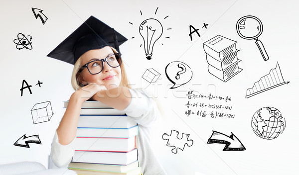 happy student woman in mortarboard with books Stock photo © dolgachov