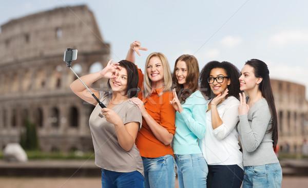 group of happy women taking selfie over coliseum Stock photo © dolgachov