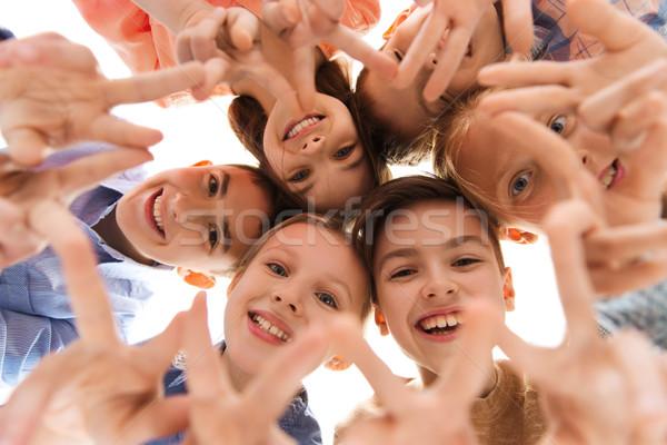 Glücklich Kinder Frieden Handzeichen Kindheit Stock foto © dolgachov