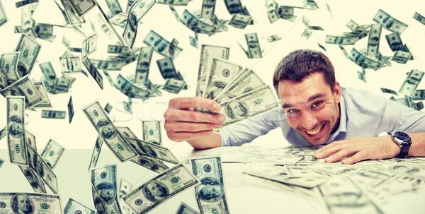 Boldog üzletember halom pénz üzletemberek siker Stock fotó © dolgachov