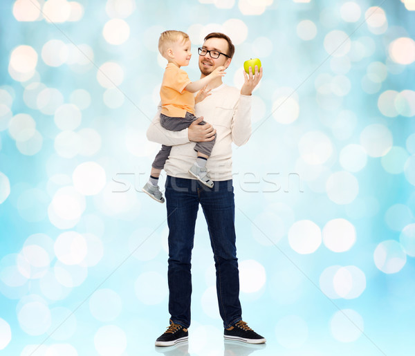 happy father and little son with green apple Stock photo © dolgachov