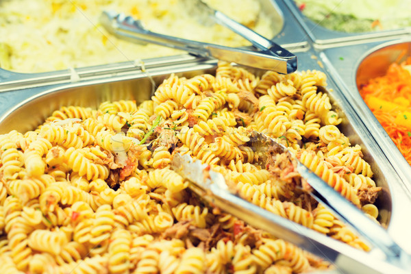 close up of pasta and dishes on catering tray Stock photo © dolgachov