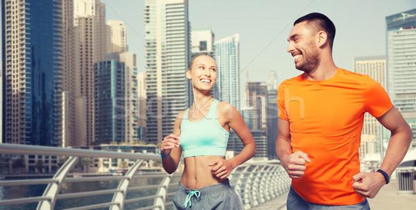 Casal corrida Dubai rua fitness esportes Foto stock © dolgachov