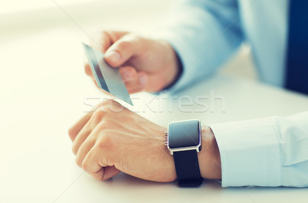 close up of hands with smart watch and credit card Stock photo © dolgachov