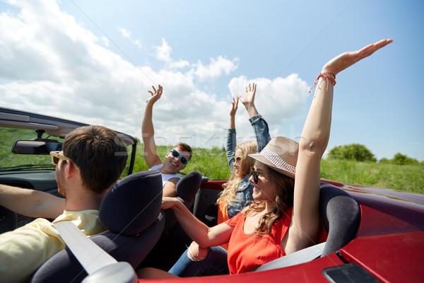 Feliz amigos condução cabriolé carro país Foto stock © dolgachov