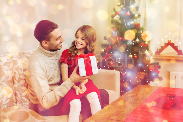 smiling father and daughter looking at each other Stock photo © dolgachov